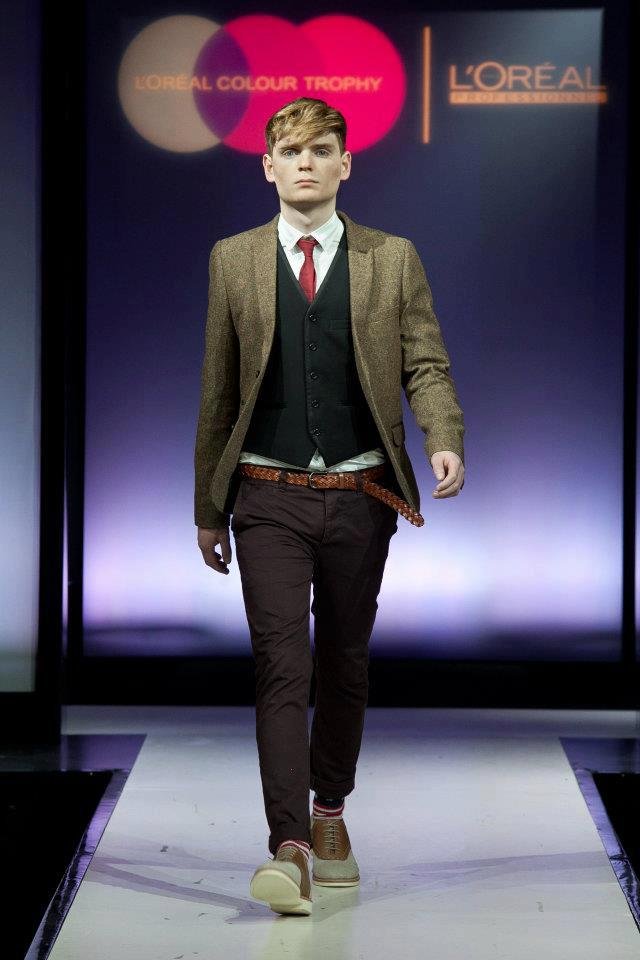man witn blonde hair on a catwalk